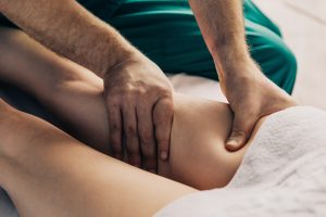 Lymphatic drainage massage of the hips.